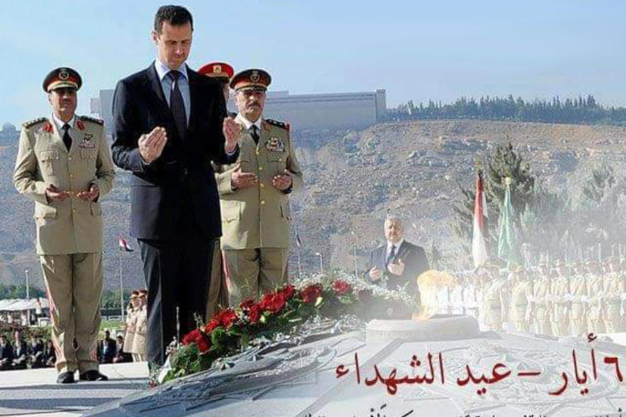 El presidente sirio, Bashar Al Asad, orando por los mártires en acto oficial del centenario (Damasco, Abril 6, 2016)